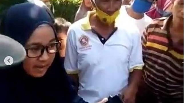 Viral wanita jilbab hitam provokasi babi ngepet di Sawangan Depok.