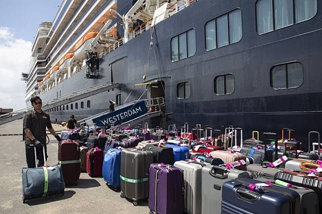 The travelers had been among the more than 2,200 passengers and crew on the Holland America Line's Westerdam cruise ship, which was turned away by five ports before disembarking in Cambodia.