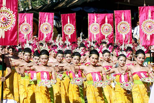 Dancers perform in a street parade for the Bali Arts Festival in Denpasar, Bali, on Saturday.