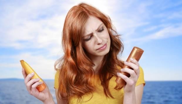 Ilustrasi perempuan sedang memilih berbagai jenis tabir surya. shutterstock.com