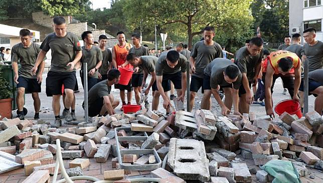 PLA soldiers sent onto streets of Hong Kong for first time since protests began - to help clear roadblocks near Kowloon Tong garrison