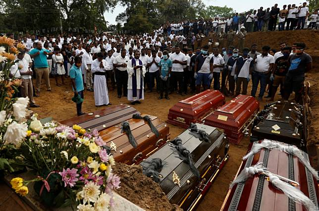 People participate in a mass funeral in Negombo, three days after a string of suicide bomb attacks on churches and luxury hotels across the island on Easter Sunday, in Sri Lanka April 24, 2019.