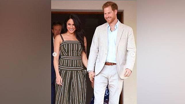 Meghan Markle dan Pangeran Harry saat menghadiri acara perayaan anak muda di Kediaman Komisaris Tinggi Inggris, di Cape Town, Afrika Selatan. Instagram/@royaladdicted