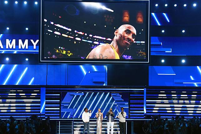 An image of the late Kobe Bryant is projected onto a screen while host Alicia Keys (2nd from L) and (from L) Nathan Morris, Wanya Morris, and Shawn Stockman of music group Boyz II Men perform onstage during the 62nd Annual GRAMMY Awards at STAPLES Center on January 26, 2020 in Los Angeles, California.
