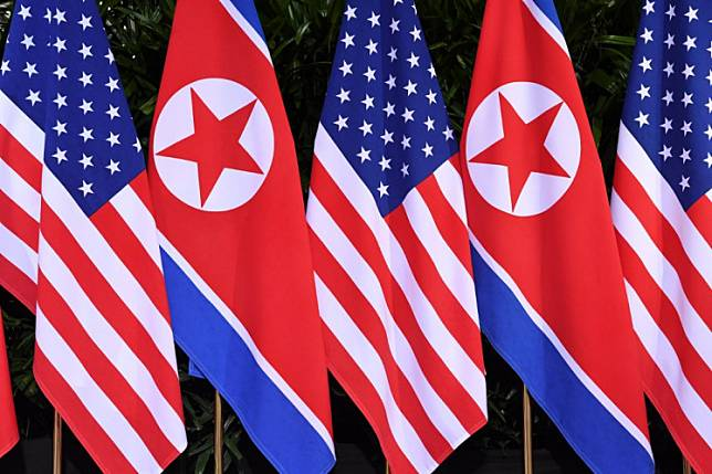 North Korean and US flags stand side by side at the location where North Korea's leader Kim Jong Un will meet with US President Donald Trump for a US-North Korea summit, at the Capella Hotel on Sentosa island in Singapore on June 12, 2018. Donald Trump and Kim Jong Un will make history on June 12, becoming the first sitting US and North Korean leaders to meet, shake hands and negotiate to end a decades-old nuclear stand-off.