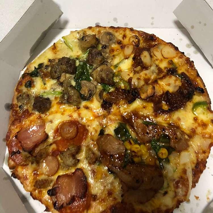 新宿区周辺で多くのユーザーに人気が高いピザドミノ・ピザ 四谷四丁目店のクワトロ・ミートマックスの写真