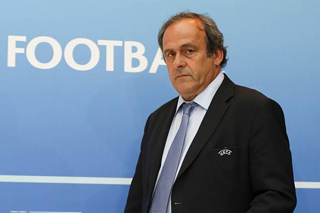 In this file photo taken on August 28, 2015 UEFA chief Michel Platini arrives for a UEFA press conference after the draw for the UEFA Europa League football group stage 2015/16 in Monaco. Ex-UEFA chief Michel Platini was arrested on June 18, 2019 in connection with a probe into the awarding of the 2022 World Cup to Qatar, a source close to the investigation said.