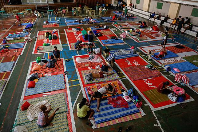 Homeless Filipinos rest on makeshift beds in a Catholic school's gymnasium which turned into a  shelter for the homeless following the enforcement of a community quarantine in the Philippine main island to contain the coronavirus disease (COVID-19), in Manila, Philippines, on Tuesday.