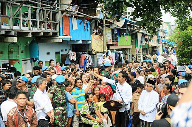 "Five more years: President-elect Joko ""Jokowi"" Widodo is accompanied by running mate Ma'ruf Amin as he delivers a victory speech to residents of Johar Baru in Central Jakarta on Tuesday."