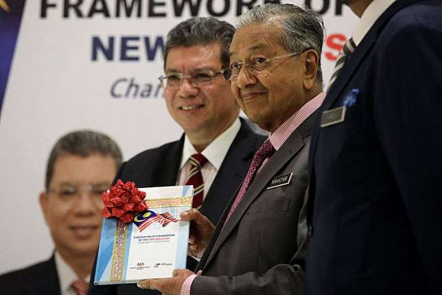 Malaysia's Prime Minister Mahathir Mohamad and Foreign Minister Saifuddin Abdullah hold publication of the Foreign Policy Framework in Putrajaya, Malaysia, September 18, 2019.