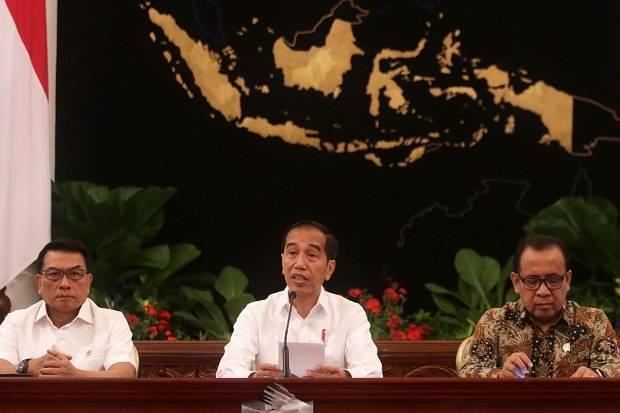 Presiden Jokowi di dampingi Kepala Staf Presiden (KSP) Moeldoko saat menyampaikan pernyataan mengenai revisi UU KPK, beberapa waktu lalu. Foto/SINDOnews