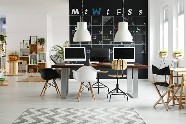 A photograph of a coworking space. Troubled office-sharing start-up WeWork is set to have a positive cash flow by next year, its executive chairman told the Financial Times on Sunday, hailing a turn-around for the high-profile company.