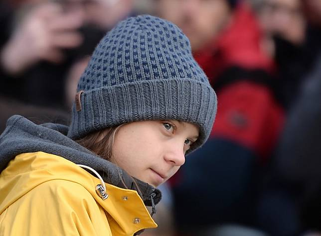 Swedish climate activist Greta Thunberg arrives to takes part at a Friday for Future strike on climate emergency, in Turin, on Dec. 13, 2019.