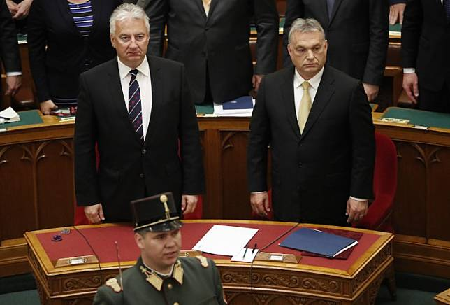 Hungarian Prime Minister Viktor Orban reacts after taking the oath of office next to Zsolt Semjen, Deputy Prime Minister, in the Parliament in Budapest, Hungary, May 10, 2018.