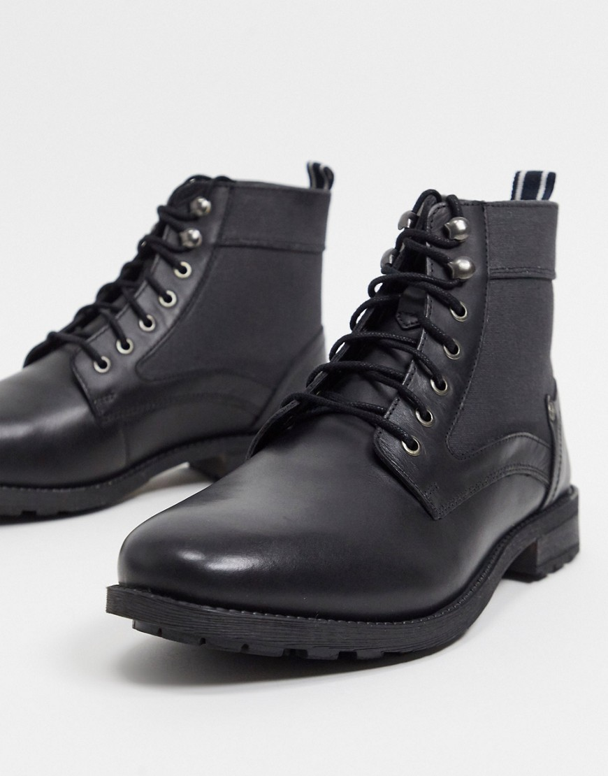 Boots by Original Penguin Two reasons to add to bag Pull tab for easy entry Lace-up fastening Round