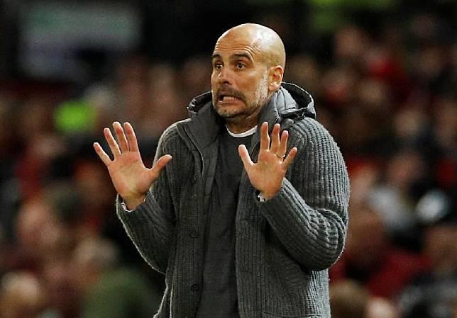 Pelatih Manchester City Pep Guardiola. Reuters/Carl Recine
