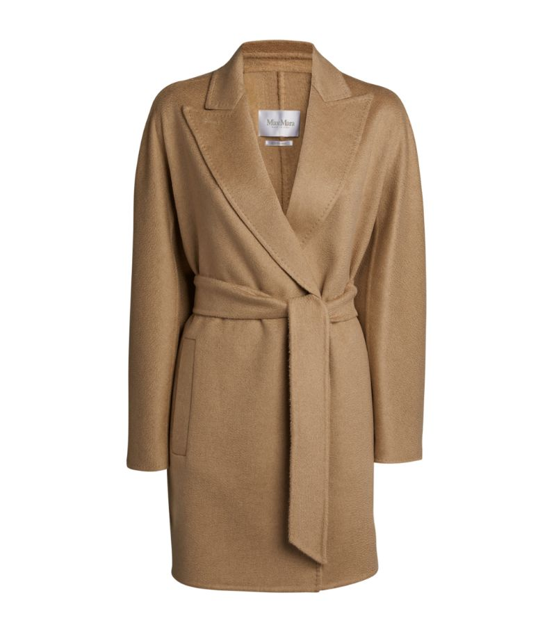 Wrap up in endless luxury with Max Mara's Rossana coat. Crafted from sumptuous virgin wool, it's ele