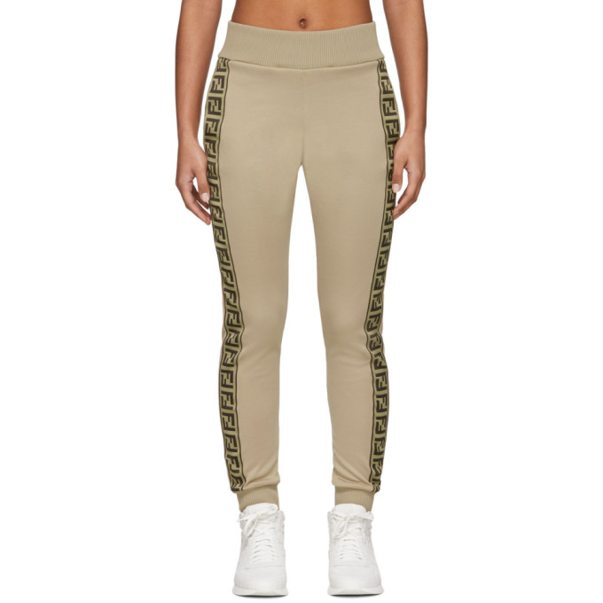 Slim-fit cotton-blend jersey lounge pants in beige. Mid-rise. Two-pocket styling. Rib knit elasticiz