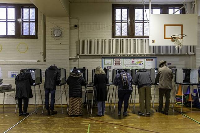 Voters cast ballots at a polling station in Minneapolis, Minnesota on November 6, 2018. The 2020 US presidential race is becoming a digital-first campaign as the coronavirus pandemic cuts candidates off from traditional organizing and in-person events.
