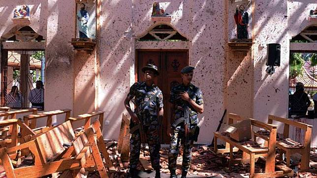 Sri Lankan military stand guard inside a church after an explosion in Negombo, Sri Lanka April 21, 2019. More than 200 people were killed and at least 450 injured in bomb blasts that ripped through churches and luxury hotels in Sri Lanka on Easter Sunday, the first major attack on the Indian Ocean island since the end of a civil war 10 years ago. REUTERS