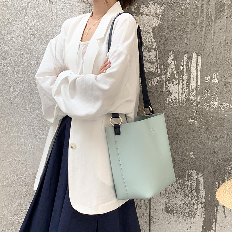 韓國東大門新款時尚極簡撞色單肩水桶包OL通勤女包休閒斜跨手提包