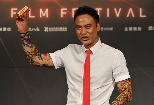 Hong Kong actor and film producer Simon Yam poses for photos during a press conference to promote Chan's latest film 'The Midnight After' in Taipei on July 13, 2014.
