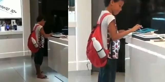 Pelajar numpang bikin tugas sekolah di toko gadget. (Foto: Cuplikan Video / Twitter @InactionNever)