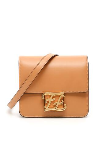 Fendi leather bag with FF Karligraphy buckle on the flap. It features a magnetic closure, removable and adjustable strap, suede lining, two gusseted compartments, five leather credit card slots. Gold-tone hardware.