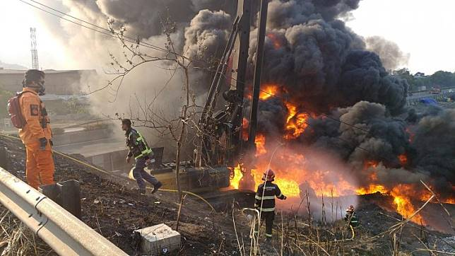 Firefighters tackle a blaze at a pipeline belonging to state-owned oil and gas company Pertamina in South Cimahi, West Java, on Tuesday.