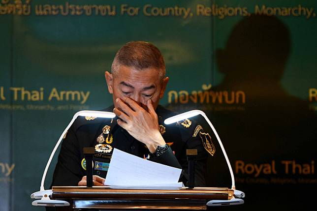 Thai army chief Apirat Kongsompong cries during a news conference in Bangkok, Thailand, following last weekend's shooting rampage by a soldier at a mall in the city of Nakhon Ratchasima, Feb. 11, 2020.