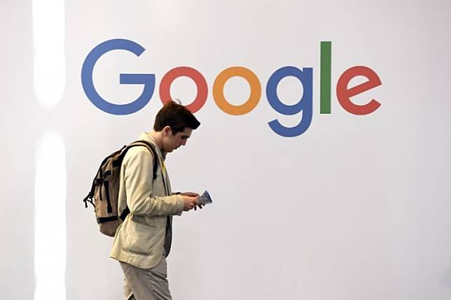 A man walks past the logo of Google during the VivaTech trade fair in Paris. Google on Monday announced that it will test a video game streaming platform with the release of 'Assassin's Creed Odyssey' by Ubisoft this week.