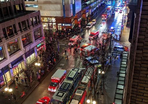 This handout image shows police activity at the scene of a shooting which left one dead and six injured on 4th Avenue and Pine street in downtown Seattle, Washington State on Jan. 22, 2020.