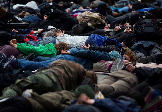 Protesters lie down for a minute of silence in the position George Floyd was in when he died during a rally against police brutality and the death in Minneapolis police custody of George Floyd, in Seattle, Washington, US June 2, 2020.