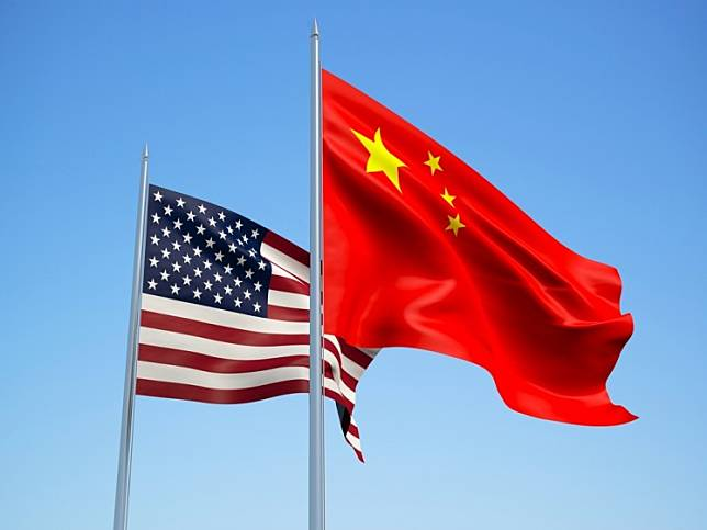 The United States and China imposed visa restrictions on each other in tit-for-tat moves over their disagreement on Tibet, adding fuel to the diplomatic fire between the superpowers.