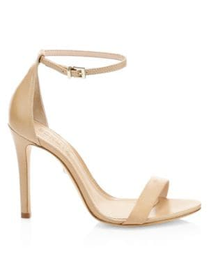 Sleek ankle-strap pumps finished in smooth leather.; Leather upper; Adjustable buckled ankle strap;