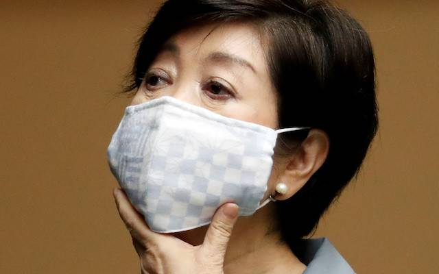 Tokyo Governor Yuriko Koike attends a joint news conference with Japan's Economy Minister Yasutoshi Nishimura and other panel members after their talks on the latest situation of the COVID-19 outbreak, in Tokyo, Japan on Friday.