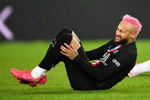 Paris Saint-Germain's Brazilian forward Neymar lies on the ground during the French L1 football match between Paris Saint-Germain (PSG) and Montpellier Herault SC at the Parc des Princes stadium in Paris, on February 1, 2020.