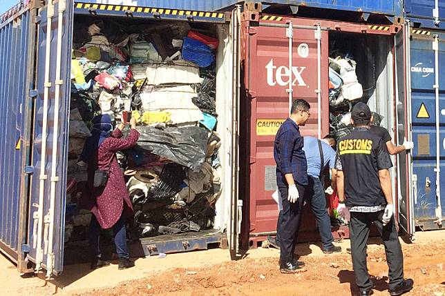 Dumping ground: Indonesian customs officers examine one of 65 containers full of imported trash at the Batu Ampar Port in Batam, Riau Islands. Indonesia returned five other containers of trash to the United States.