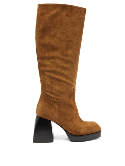 Nodaleto - Channel Nodaleto's signature 1970s-inspired aesthetic with these brown Bulla boots, which